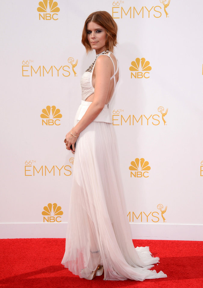 Photo - Kate Mara arrives at the 66th Annual Primetime Emmy Awards at the Nokia Theatre L.A. Live on Monday, Aug. 25, 2014, in Los Angeles. (Photo by Jordan Strauss/Invision/AP)