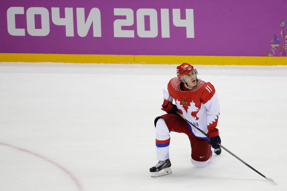 Photo - Russia forward Yevgeni Malkin looks up at the scoreboard after men's quarterfinal hockey game against Finland in Bolshoy Arena at the 2014 Winter Olympics, Wednesday, Feb. 19, 2014, in Sochi, Russia. Finland defeated Russia 3-1. (AP Photo/David J. Phillip )
