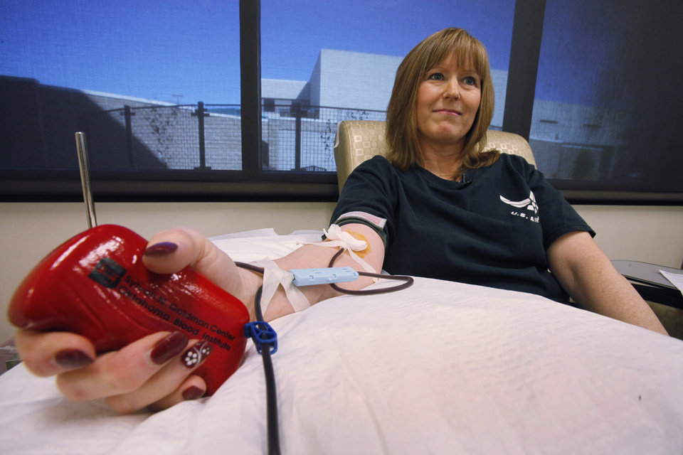 Debi Croft gives blood at the Oklahoma Blood Institute, Tuesday, March 13, 2012. Photo By David McDaniel/The Oklahomen