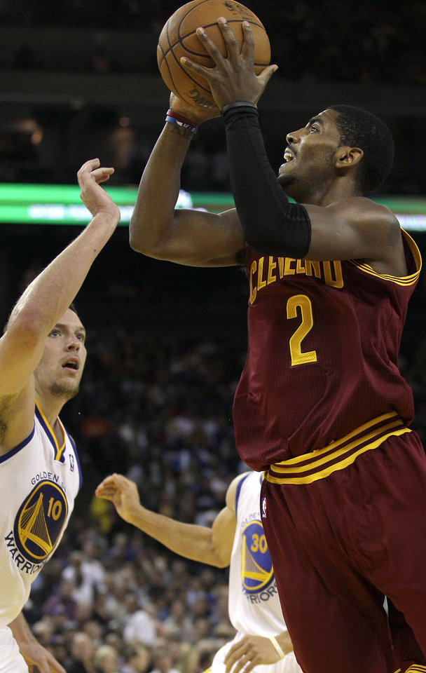 Cleveland Cavaliers guard Kyrie Irving (2) shoots against Golden State Warriors forward David Lee during the second quarter of an NBA basketball game in Oakland, Calif., Wednesday, Nov. 7, 2012. (AP Photo/Jeff Chiu)