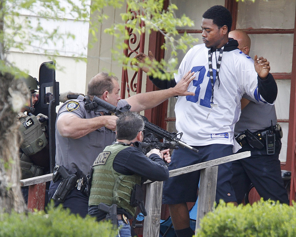 Photo - Oklahoma City Police and the FBI take a suspect into custody in connection to the robbery of MidFirst Bank in Oklahoma City , Friday April 12, 2013. The suspect was in a home at 3024 NE 16th street. Photo By Steve Gooch, The Oklahoman