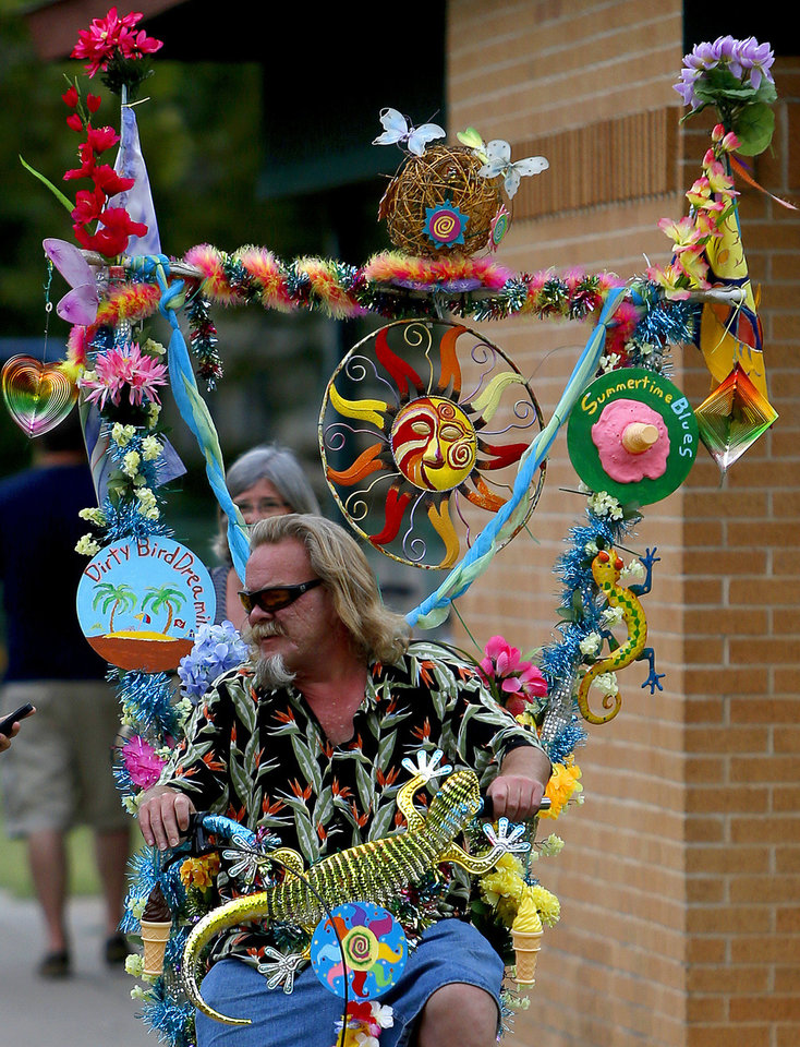 Ed Kearns rides his bike during the Midsummer Nights� Fair in Norman.  Photos by Bryan Terry, The Oklahoman