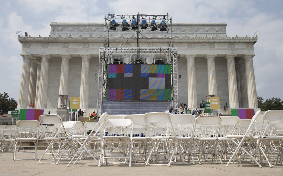 Chairs, metal risers and video screens are set up at the Lincoln Memorial in Washington, Tuesday, Aug. 27, 2013, in preparation for the 50th anniversary of the March On Washington celebrations that will be held Wednesday, Aug, 28, 2013. Barack Obama, who is going to speak, was 2 years old and growing up in Hawaii when Martin Luther King Jr. delivered his �I Have a Dream� speech from the steps of the Lincoln Memorial. Fifty years later, the nation�s first black president will stand as the most high-profile example of the racial progress King espoused, delivering remarks at a nationwide commemoration of the 1963 demonstration for jobs, economic justice and racial equality.   (AP Photo/Carolyn Kaster)