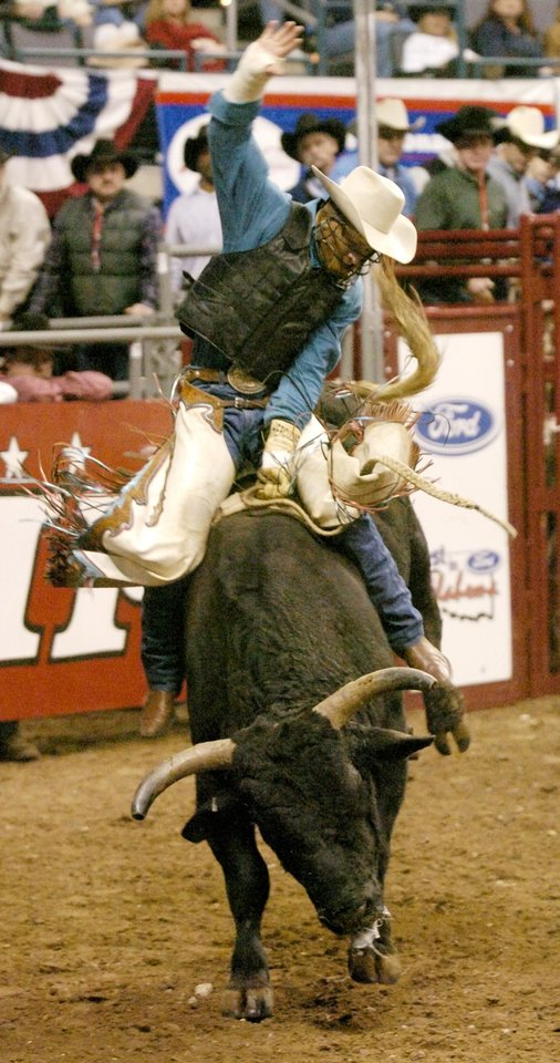 Oklahoma City - January, 17, 2004. Cord McCoy of Tupelo, Okla., competes in bull riding during the 3rd go-round of the International Finals Rodeo (IFR 34) at the Ford Center Saturday afternoon. Staff photo by Nate Billings.