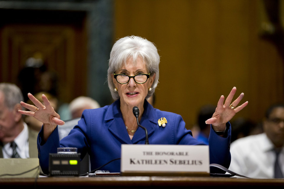 Photo - In this Nov. 6, 2013, file photo, Health and Human Services Secretary Kathleen Sebelius testifies on Capitol Hill in Washington on the difficulties plaguing the implementation of the Affordable Care Act. Putting a statistic on disappointment, the Obama administration revealed Wednesday, Nov. 13, that fewer than 27,000 people signed up for private health insurance last month in the 36 states relying on a problem-filled federal website. (AP Photo/J. Scott Applewhite, File)