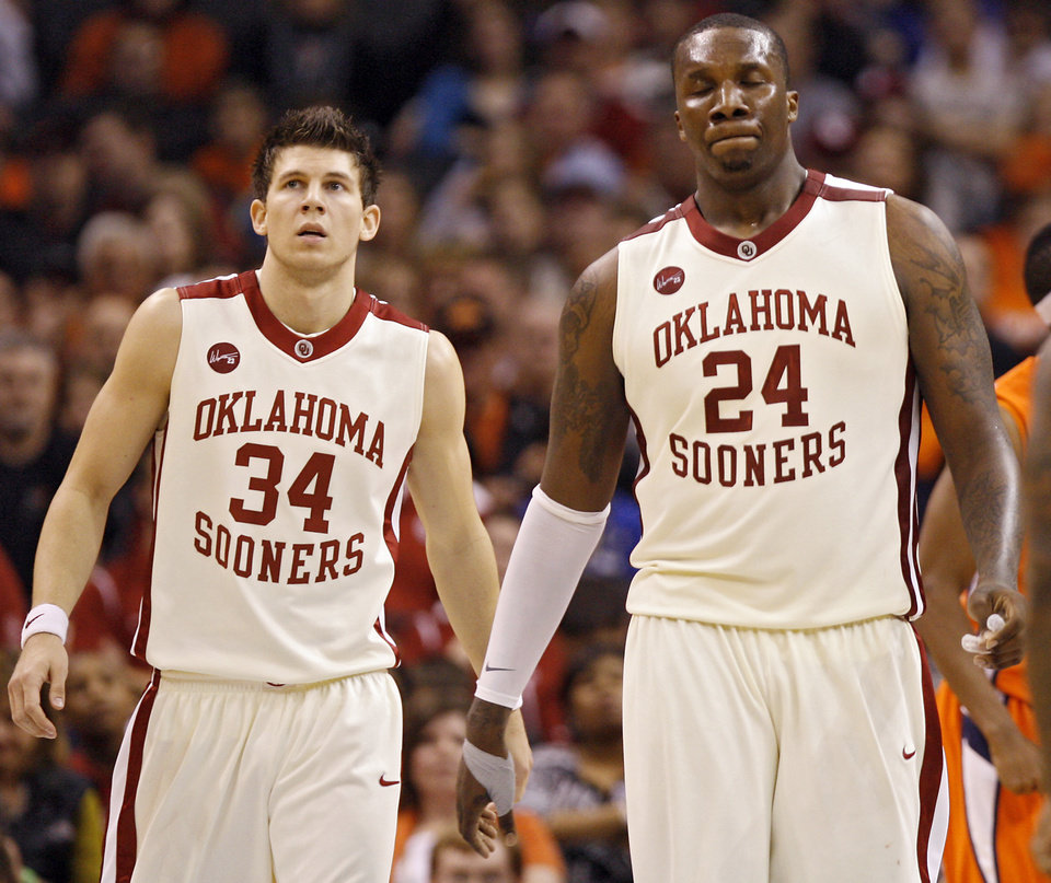 Photo - Oklahoma's Tiny Gallon (24) and Cade Davis (34) react in the 89-74 loss during the second half of the college basketball game between the University of Oklahoma (OU) and the University of Texas El Paso (UTEP) in the All College Basketball Classic at the Ford Center on Monday, Dec. 21, 2009, in Oklahoma City, Okla.   Photo by Chris Landsberger, The Oklahoman ORG XMIT: KOD
