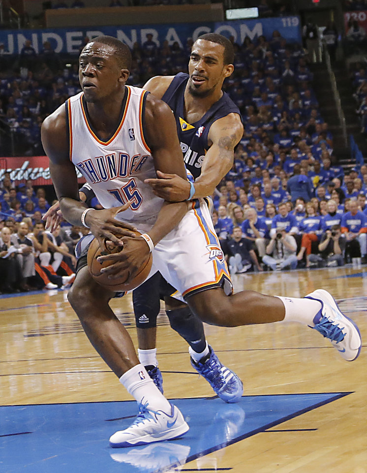 Photo - Oklahoma City's Reggie Jackson (15) drives past Memphis' Mike Conley (11) during the second round NBA playoff basketball game between the Oklahoma City Thunder and the Memphis Grizzlies at Chesapeake Energy Arena in Oklahoma City, Sunday, May 5, 2013. Photo by Chris Landsberger, The Oklahoman