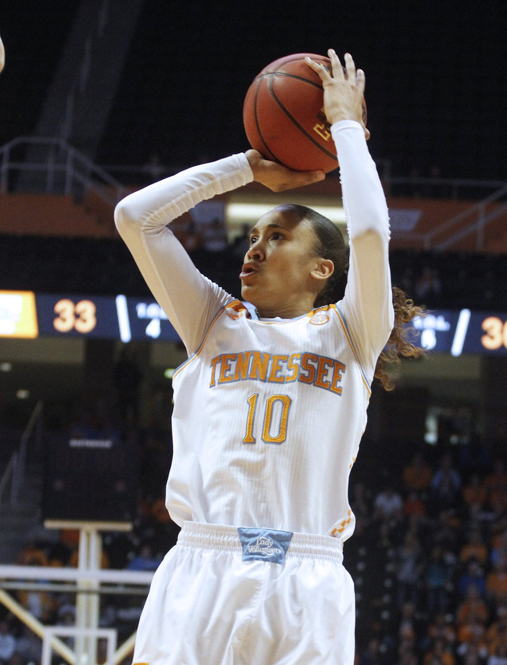 Photo - Tennessee guard Meighan Simmons takes a shot during the first half of an NCAA college basketball game against Arkansas, Thursday, Jan. 30, 2014, in Knoxville, Tenn. (AP Photo/Lisa Norman-Hudson)