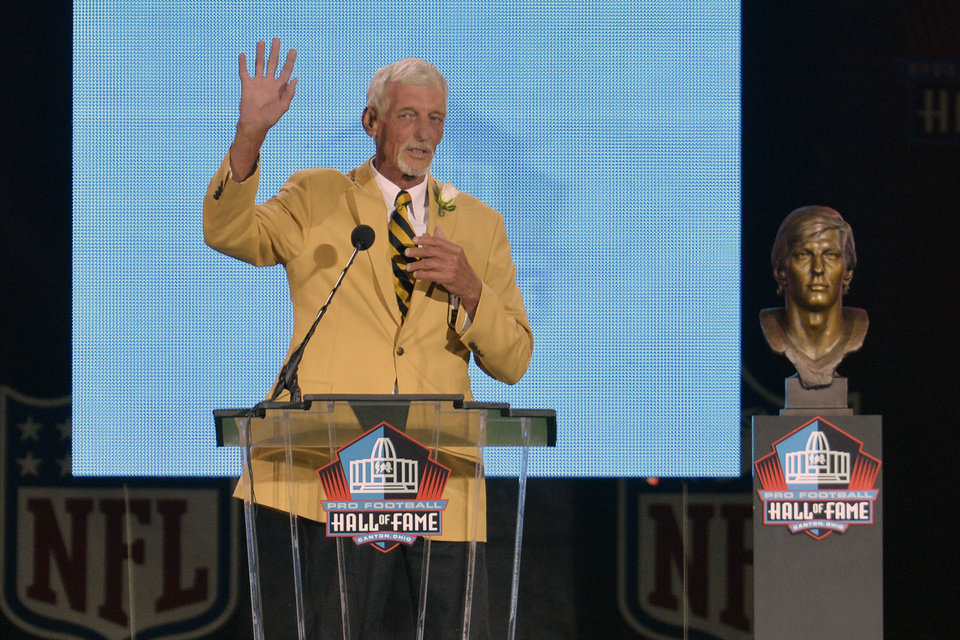 Photo - Hall of Fame inductee Ray Guy speaks during the 2014 Pro Football Hall of Fame Enshrinement Ceremony at the Pro Football Hall of Fame Saturday, Aug 2, 2014 in Canton, Ohio. (AP Photo/David Richard)