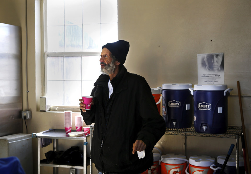 Photo - Gary Duncan re-fills his cup with hot coffee after finishing his meal at the Jesus House. Many Oklahomans are dealing with frigid sub-freezing temperatures, part of a major winter storm that continues to grip much of the central sections and the eastern half of the United States. Photo taken Monday, Jan. 6, 2014.  Photo by Jim Beckel, The Oklahoman