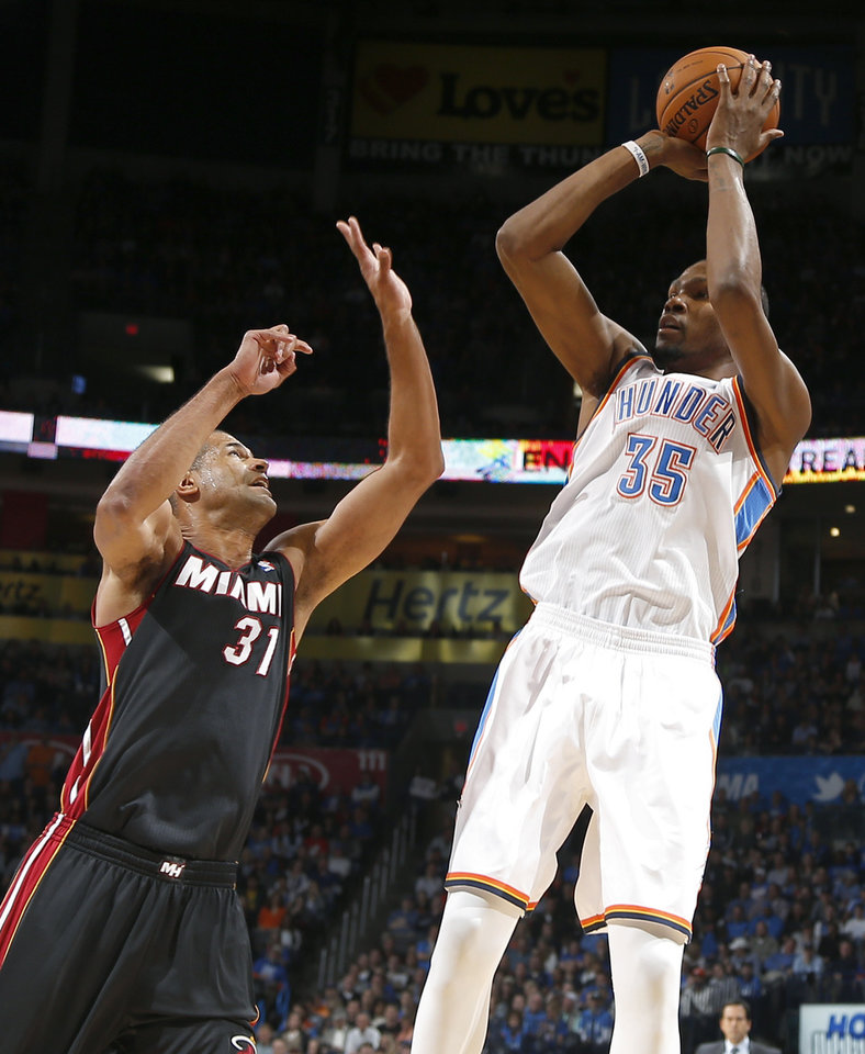 Oklahoma City's Kevin Durant (35) shoots over Miami's Shane Battier (31) during an NBA basketball game between the Oklahoma City Thunder and the Miami Heat at Chesapeake Energy Arena in Oklahoma City, Thursday, Feb. 20, 2014. Photo by Bryan Terry, The Oklahoman