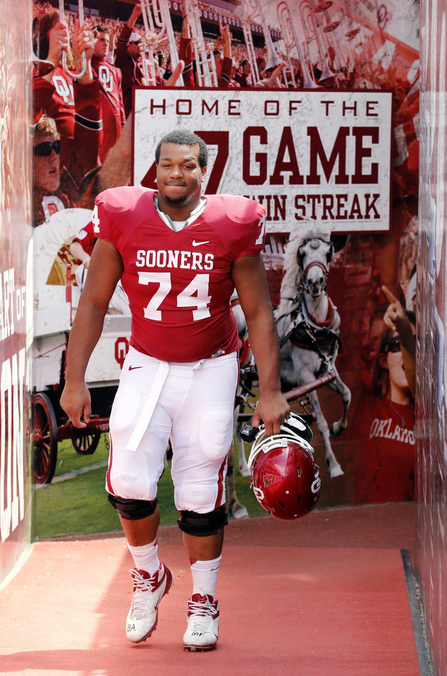 Photo - Adam Shead (74) steps onto the filed before the annual Spring Football Game at Gaylord Family-Oklahoma Memorial Stadium in Norman, Okla., on Saturday, April 13, 2013. Photo by Steve Sisney, The Oklahoman