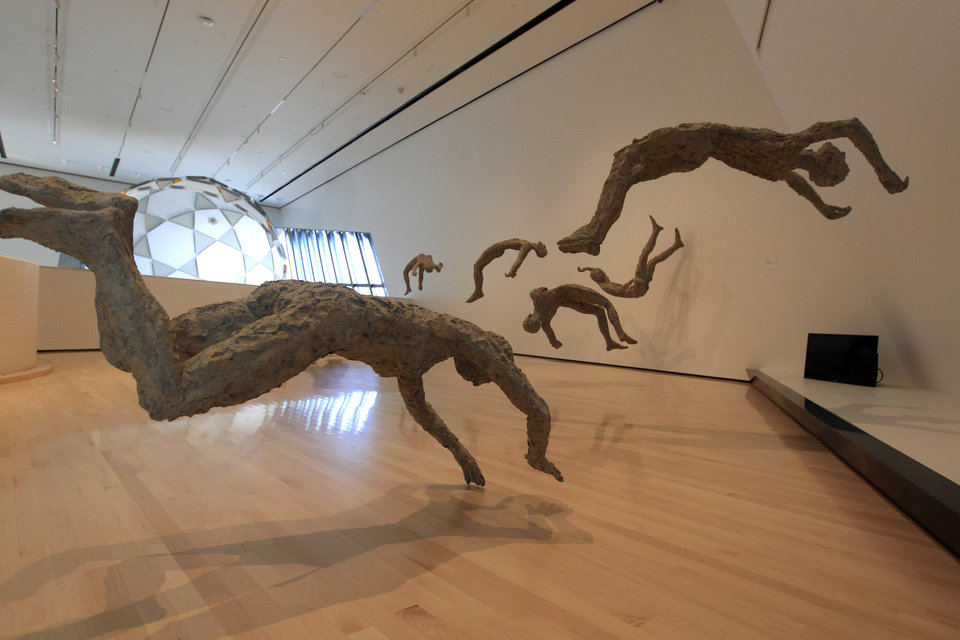 Photo -   In this Nov. 9, 2012 Chen Quilin's Floating series is displayed at the Eli and Edythe Broad Art Museum on Michigan State University's campus in East Lansing, Mich. (AP Photo/Carlos Osorio)