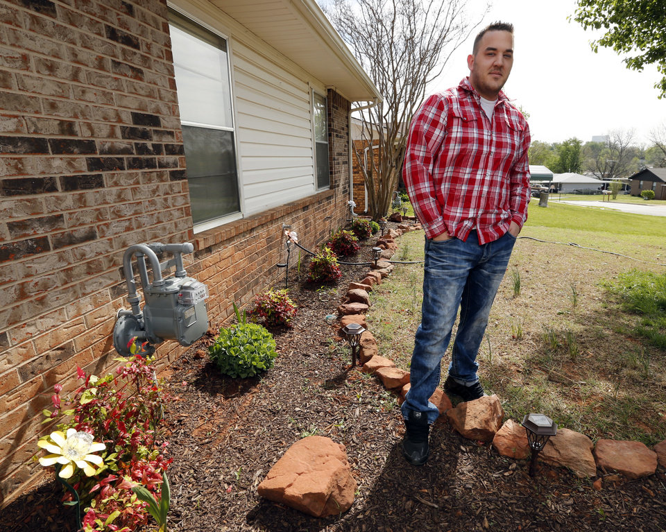 Photo - Joshua Sparks, prison guard, at his home on April 16, 2014 in Purcell, Okla. Photo by Steve Sisney, The Oklahoman
