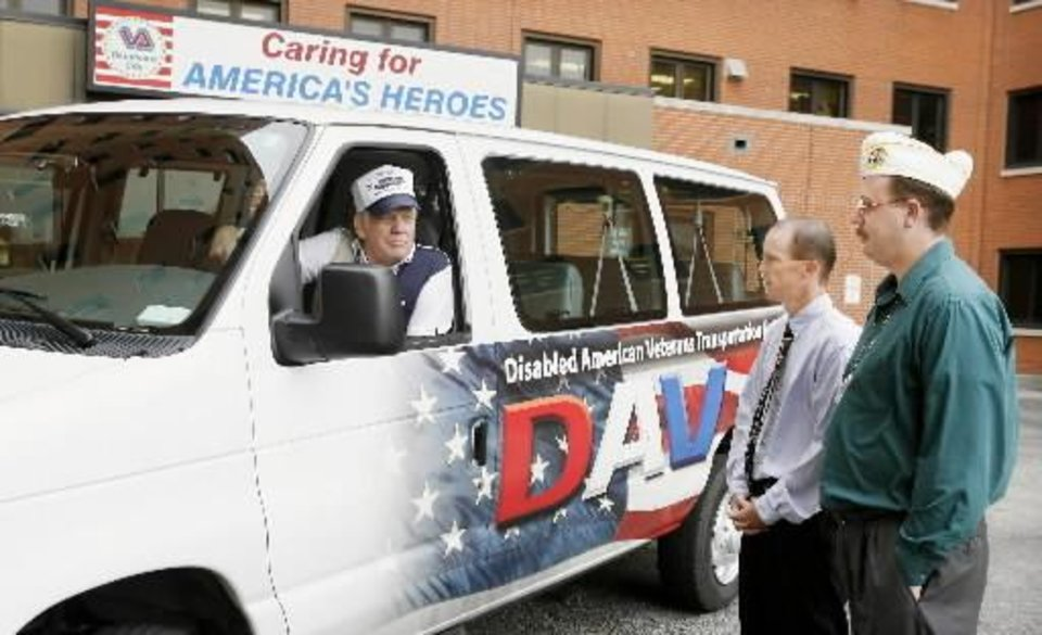 Photo - Braden McGlugritch,  Disabled  American  Veterans (DAV) volunteer  van driver, talks with Richard Maxey, VA Hospital chief of voluntary services, and Eric Anderson, DAV hospital service coordinator, at one of the entrances to the VA Hospital in Oklahoma City Tuesday, Sept. 9, 2008. BY PAUL B. SOUTHERLAND