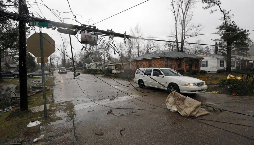 Photo - Areas of Hattiesburg, Miss., are still without power  Monday, Feb. 11, 2013 following Sunday's afternoon tornado that caused extensive damage throughout the South Mississippi college town. Transformers, power poles and many power lines are down along the areas hit by the tornado. (AP Photo/Rogelio V. Solis)