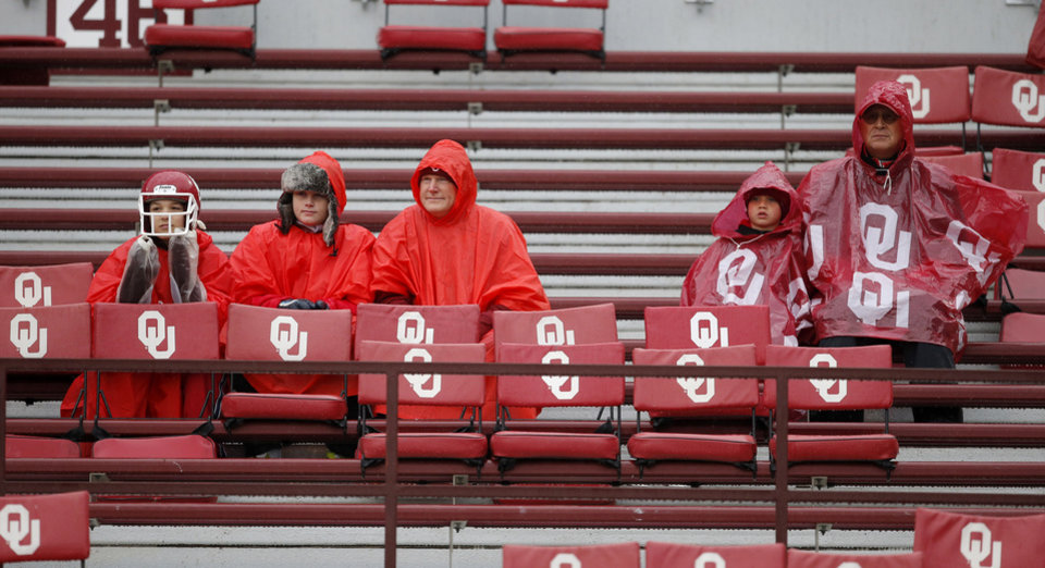 Photo - Oklahoma fans wait for the start of the Bedlam college football game between the Oklahoma Sooners (OU) and the Oklahoma State Cowboys (OSU) at Gaylord Family - Oklahoma Memorial Stadium in Norman, Okla., Saturday, Dec. 3, 2016. Photo by Bryan Terry, The Oklahoman