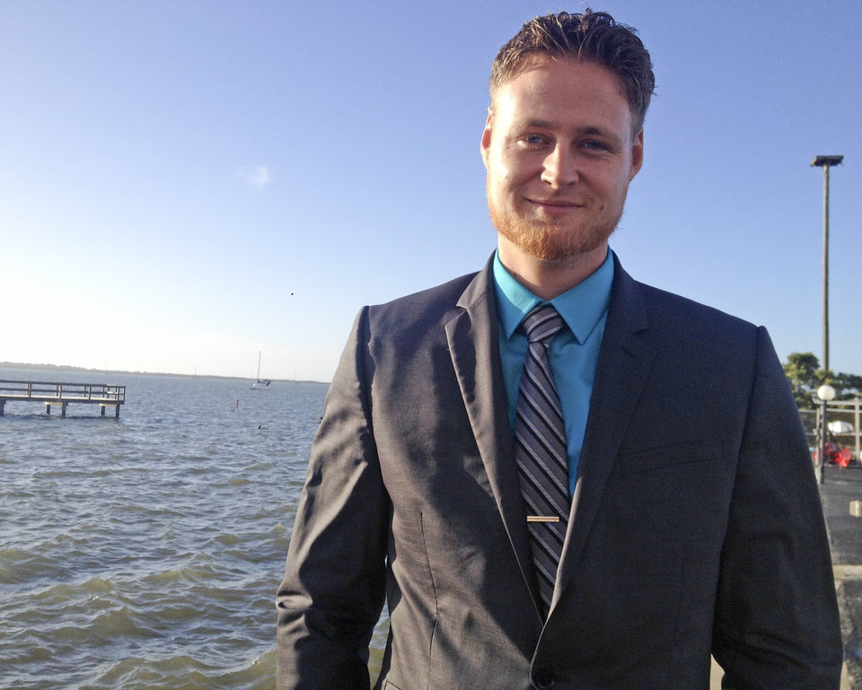 Photo - In this photo taken on Thursday, March 6,2 014, Lucas Overby, a 27-year-old Pinellas County resident, campaigns for Congress in Dunedin, Fla. Overby is the Libertarian candidate running against Democrat Alex Sink and Republican David Jolly. (AP Photo/Tamara Lush)