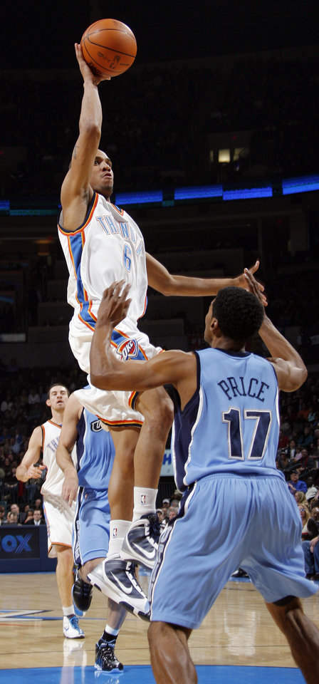 Photo - Oklahoma City's Eric Maynor (6) takes a shot over Ronnie Price of Utah in the second quarter during the NBA basketball game between the Oklahoma City Thunder and the Utah Jazz at the Ford Center in Oklahoma City, Thursday, December 31, 2009. Photo by Nate Billings, The Oklahoman