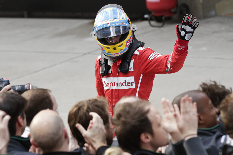 Photo - Ferrari driver Fernando Alonso of Spain celebrates after winning the third place after the Chinese Formula One Grand Prix at Shanghai International Circuit in Shanghai, Sunday, April 20, 2014. (AP Photo/Alexander F. Yuan)