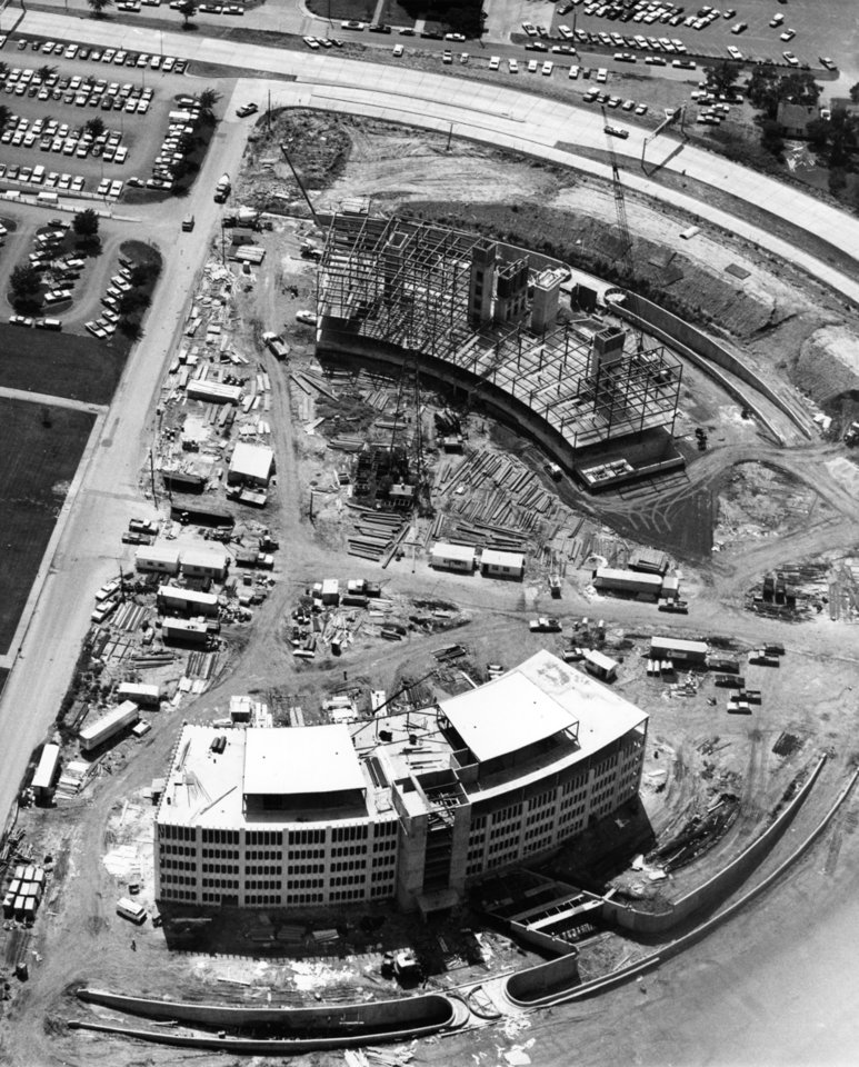 "Photo - AERIAL VIEW:   'TWIN BUILDINGS at north end of (Oklahoma) state capitol complex on N Lincoln are scheduled for completion early next year (1974).  Education building (Hodge Building), in foreground, is farther along because Tax Commission building (Conners Building), in background, involved considerably more excavation work.  The two buildings are being constructed as one $8 million project.  A tunnel will connect Education Department building to Sequoyah Building and another will link Tax Commission and Will Rogers buildings.  Picture is looking west."" Staff photo by Al McLaughlin probably taken 7/21/1973; photo ran in the 7/22/1973 Daily Oklahoman."