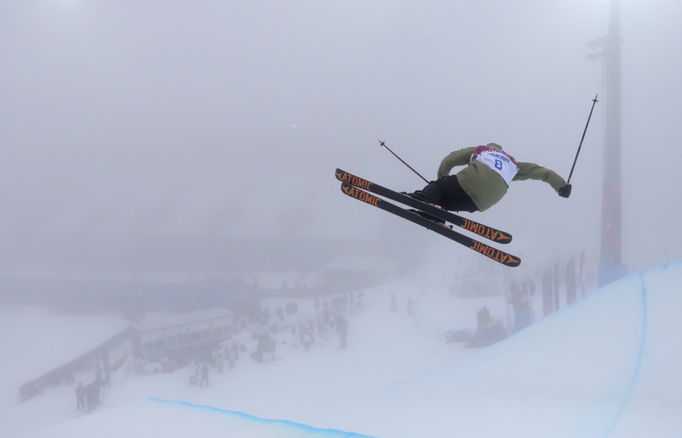 Photo - Yannic Lerjen from Switzerland trains in the halfpipe during a freestyle skiing training session at the Rosa Khutor Extreme Park, at the 2014 Winter Olympics, Monday, Feb. 17, 2014, in Krasnaya Polyana, Russia. (AP Photo/Sergei Grits)