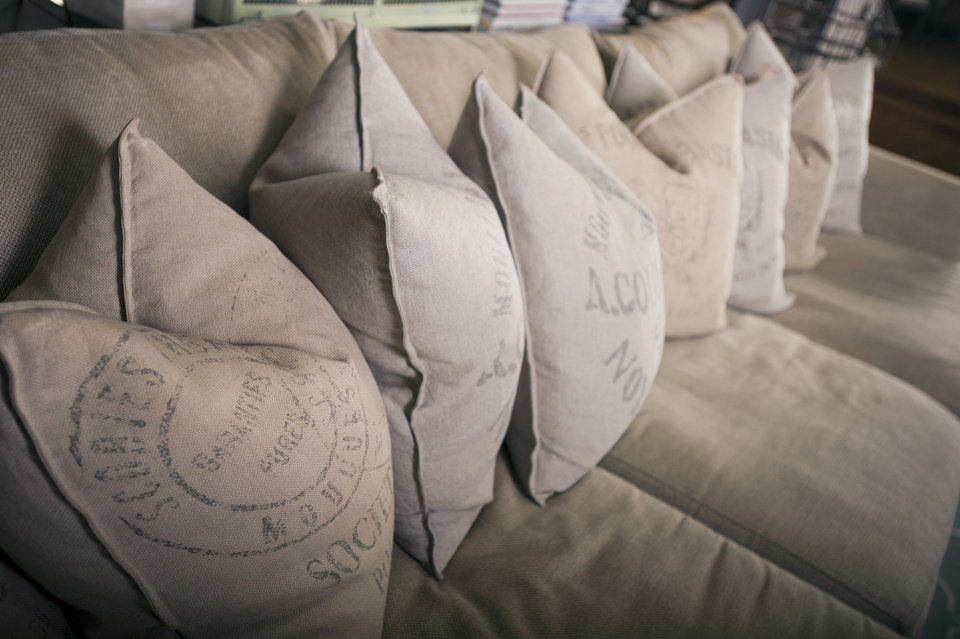 A line of pillows on the sofa in the living room of Christian Siriano\'s New York City apartment is featured, September 11, 2012. (Karl Merton Ferron/Baltimore Sun/MCT)