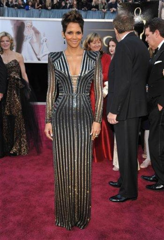 Photo - Actress Halle Berry arrives at the Oscars at the Dolby Theatre on Sunday Feb. 24, 2013, in Los Angeles. (Photo by John Shearer/Invision/AP)