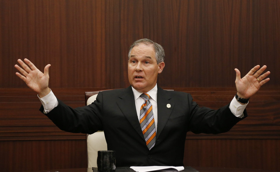 Oklahoma Attorney General Scott Pruitt gestures as he answers a question during a news conference in Oklahoma City on Tuesday.  (AP Photo/Sue Ogrocki) <strong>Sue Ogrocki</strong>