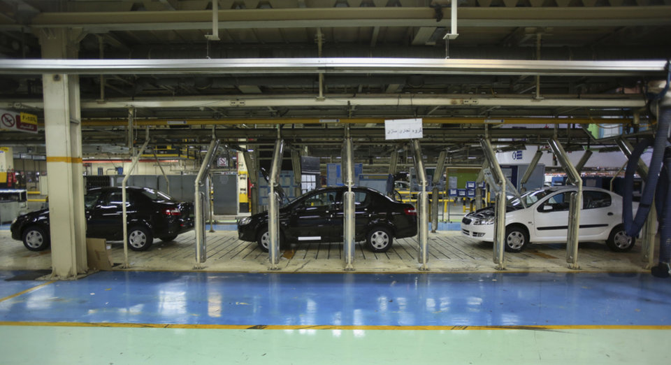 Photo - Cars are seen in a production line of the state-run Iran-Khodro automobile manufacturing plant near Tehran, Iran, Sunday, June 29, 2014. Iran began exporting automobiles to Russia for the first time in five years on Sunday, after meeting upgraded emission standards, the country's largest auto manufacturer said. (AP Photo/Vahid Salemi)