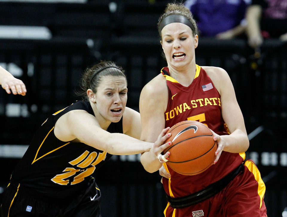 Iowa  guard Samantha Logic (22) tries to knock the ball away from Iowa State forward Hallie Christofferson (5) during the first half an NCAA college basketball game Thursday, Dec. 6, 2012 at Carver-Hawkeye Arena in Iowa City, Iowa. (AP Photo/The Gazette,Brian Ray)