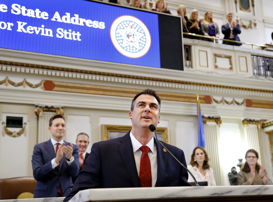 Photo - Gov. Kevin Stitt said teachers deserve another pay raise and asked state lawmaker for the money to fund it in his first State-of-the-State address, which he also used to outline his vision for an economy-focused administration that will produce an efficient and adaptive state government. He outlined his plans moving forward in his first term as governor while speaking to lawmakers on Monday, Feb. 4, 2019, as the 57th Legislature officially began.  Photo by Jim Beckel, The Oklahoman.