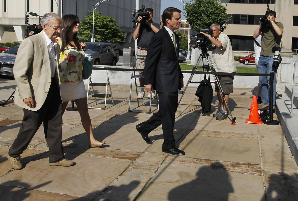 Photo -   Former Sen. John Edwards, right, leads his father Wallace Edwards and daughter Cate Upham into the Federal Courthouse in Greensboro, N.C. Wednesday, May 2, 2012. Edwards is accused of conspiring to secretly obtain more than $900,000 from two wealthy supporters to hide his extramarital affair with Rielle Hunter and her pregnancy from the media. He has pleaded not guilty to six charges related to violations of campaign-finance laws. (AP Photo/The News & Observer, Chuck Liddy) MANDATORY CREDIT