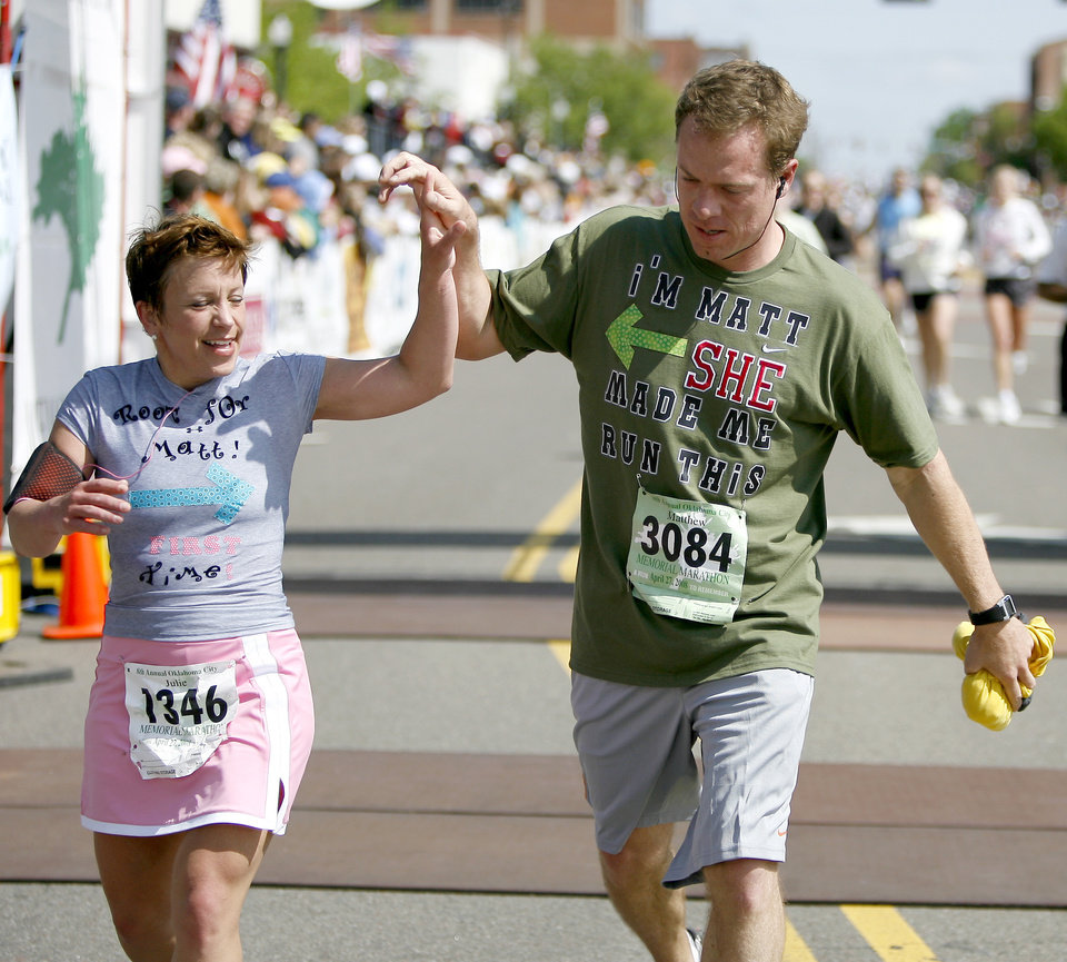 Matthew and Julie Brower cross the finish line during the Oklahoma City Memorial Marathon, Sunday, April 27, 2008.  BY BRYAN TERRY, THE OKLAHOMAN