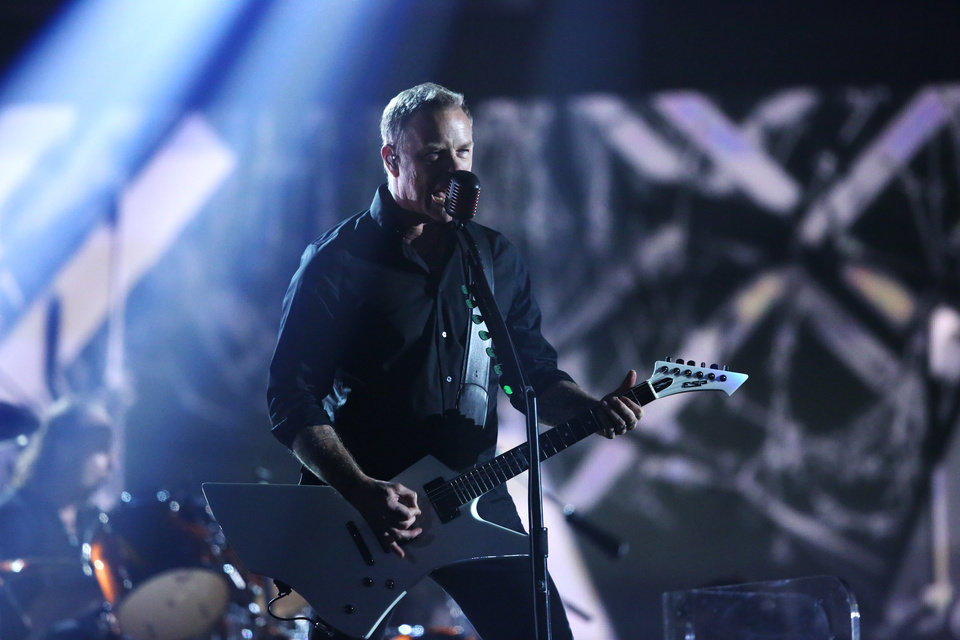 """Photo - James Hetfield of Metallica performs """"One"""" at the 56th annual Grammy Awards at Staples Center on Sunday, Jan. 26, 2014, in Los Angeles. (Photo by Matt Sayles/Invision/AP)"""