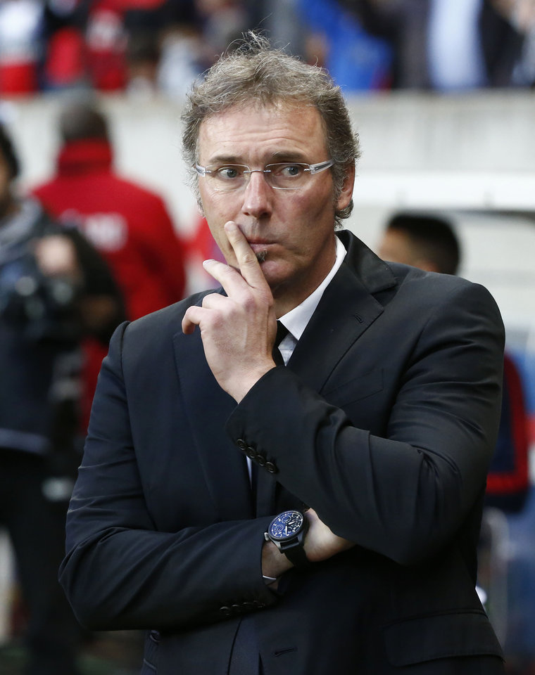 Photo - Paris Saint-Germain's coach Laurent Blanc looks on prior to a French league one soccer match between Paris-Saint-Germain and Rennes at Parc des Princes stadium in Paris, Wednesday, May 7, 2014. Paris Saint-Germain clinched their second straight French league title on Wednesday after rival Monaco drew 1-1 against French Cup holder Guingamp. (AP Photo/Michel Euler)