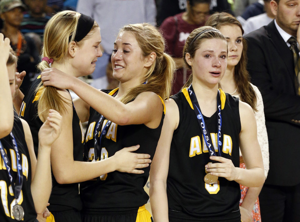 Alva players Lora Eiley, center, consoles Jayna Hadwiger following the 2A girls championship game where the Northeast Academy Lady Vikings defeated the Alva high school Lady Bugs 53-36 at the State Fair Arena on Saturday, March 9, 2013 in Oklahoma City, Okla.  Photo by Steve Sisney, The Oklahoman