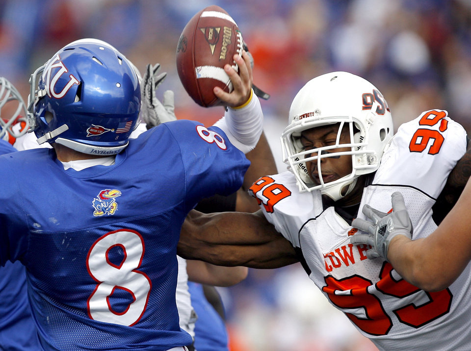 Photo - Oklahoma State's Richetti Jones (99) pressures Kansas' Quinn Mecham (8)during the college football game between Oklahoma State (OSU) and Kansas (KU), Saturday, Nov. 20, 2010 at Memorial Stadium in Lawrence, Kan. Photo by Sarah Phipps, The Oklahoman