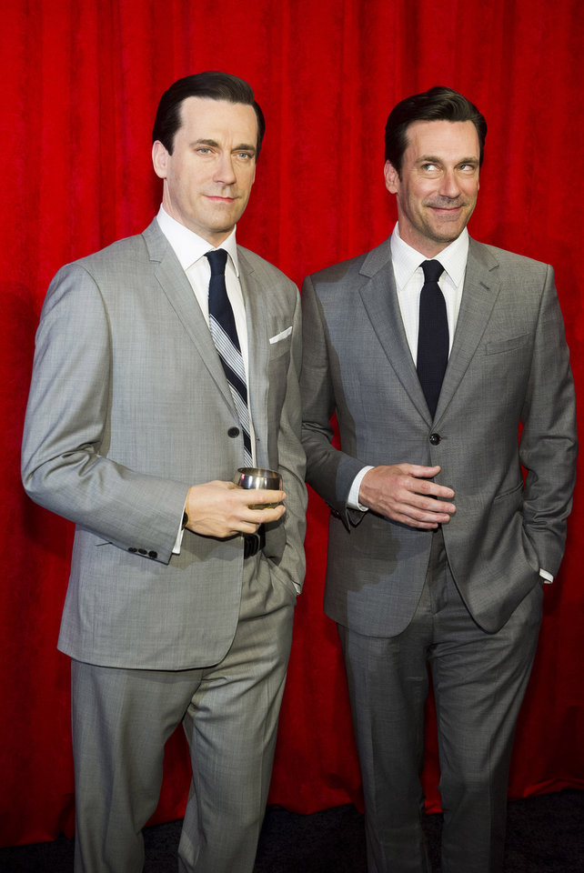 Photo - AP10ThingsToSee - Jon Hamm, right, poses with his wax likeness at an unveiling at Madame Tussauds on Friday, May 9, 2014, in New York. (Photo by Charles Sykes/Invision/AP)