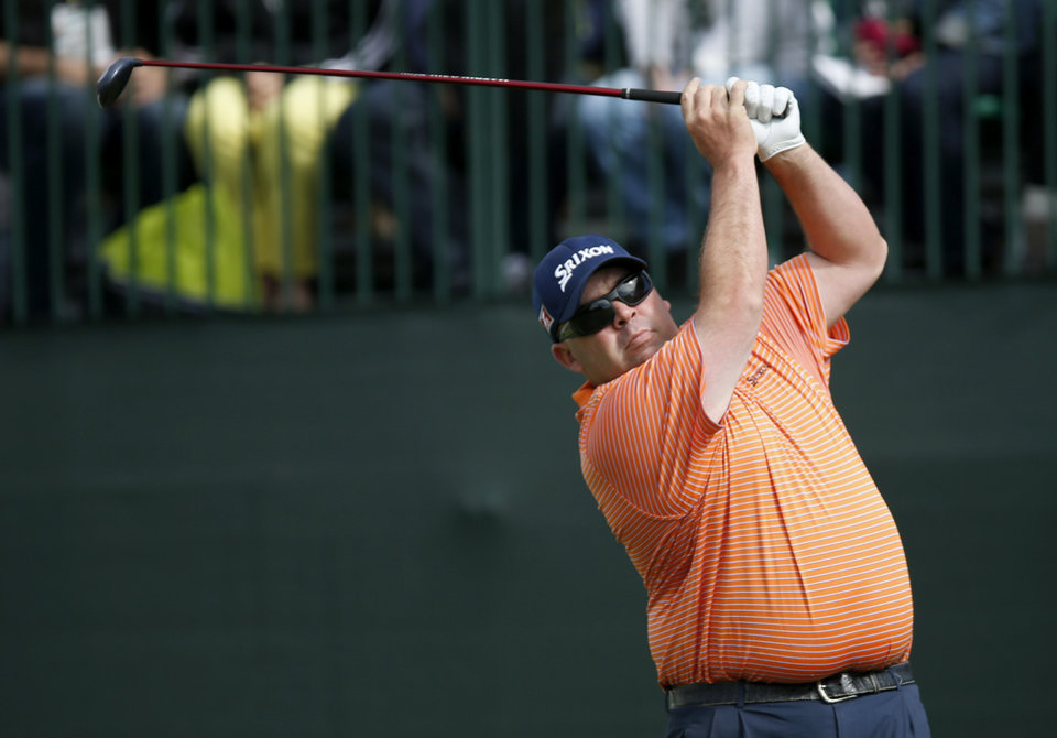 Photo - Kevin Stadler hits his tee shot at the 10th hole during the final round of the Phoenix Open golf tournament on Sunday, Feb. 2, 2014, in Scottsdale, Ariz. (AP Photo/Ross D. Franklin)