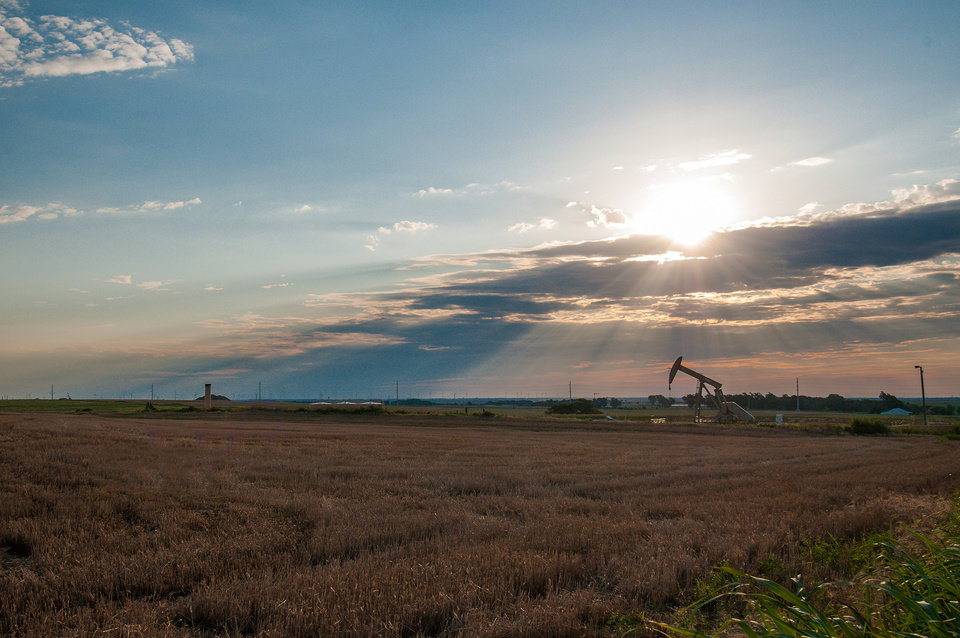 Photo -  A Devon Energy Corp. well produces oil in central Oklahoma's STACK field. [Photo provided]