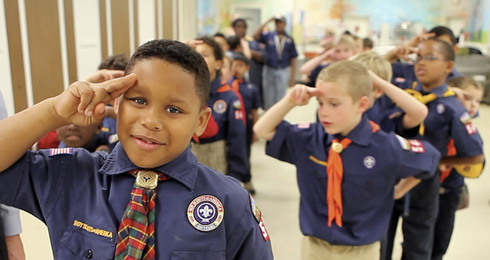 Nacio salutes as he leads the pledge of allegiance during the Cub Scout pack meeting at Villa Teresa School. PHOTOS BY David McDaniel, The Oklahoman