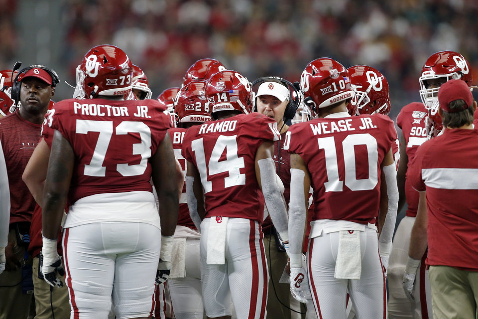Photo - Oklahoma coach Lincoln Riley talks with his team during the Big 12 Championship Game between the University of Oklahoma Sooners (OU) and the Baylor University Bears at AT&T Stadium in Arlington, Texas, Saturday, Dec. 7, 2019. Oklahoma won 30-23. [Bryan Terry/The Oklahoman]