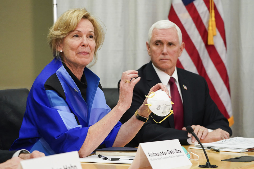 Photo -  FILE - In this March 5, 2020, file photo, Dr. Deborah Birx, Ambassador and White House coronavirus response coordinator, holds a 3M N95 mask as Vice President Mike Pence visits 3M headquarters in Maplewood, Minn., in a meeting with 3M leaders and Minnesota Gov. Tim Walz to coordinate response to the COVID-19 virus. A review of federal purchasing contracts by The Associated Press shows federal agencies waited until mid-March to begin placing bulk orders of N95 respirator masks, mechanical ventilators and other equipment needed by front-line health care workers. (Glen Stubbe/Star Tribune via AP, File)