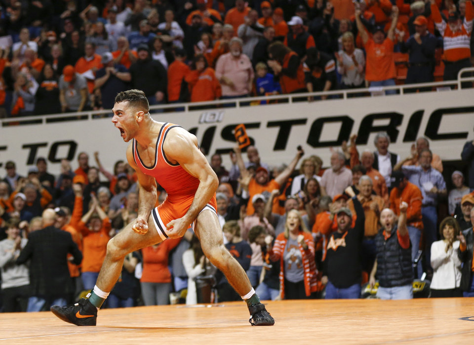 Photo -  OSU's Nick Piccininni reacts after pinning Iowa's Spencer Lee in a 125-pound match on Sunday at Gallagher-Iba Arena in Stillwater. OSU routed the Hawkeyes, 27-12. [Nate Billings/The Oklahoman]
