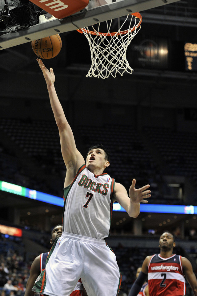 Milwaukee Bucks' Ersan Ilyasova (7) scores two points against the Washington Wizards during the second half of an NBA basketball game Monday, Feb. 11, 2013, in Milwaukee. (AP Photo/Jim Prisching)