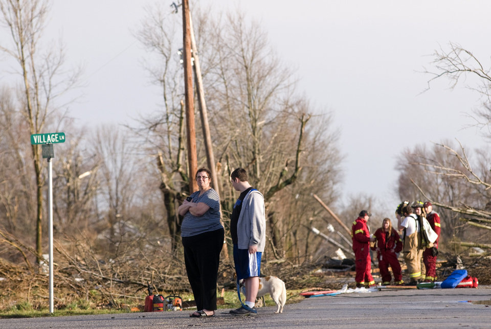 Residents of Marysville, Ind., survey the tornado damage to their homes Friday, March 2, 2012 in Marysville. Powerful storms stretching from the U.S. Gulf Coast to the Great Lakes in the north wrecked two small towns, killed at least three people and bred anxiety across a wide swath of the country on Friday, in the second deadly tornado outbreak this week. (AP Photo/Brian Bohannon) ORG XMIT: KYBB111
