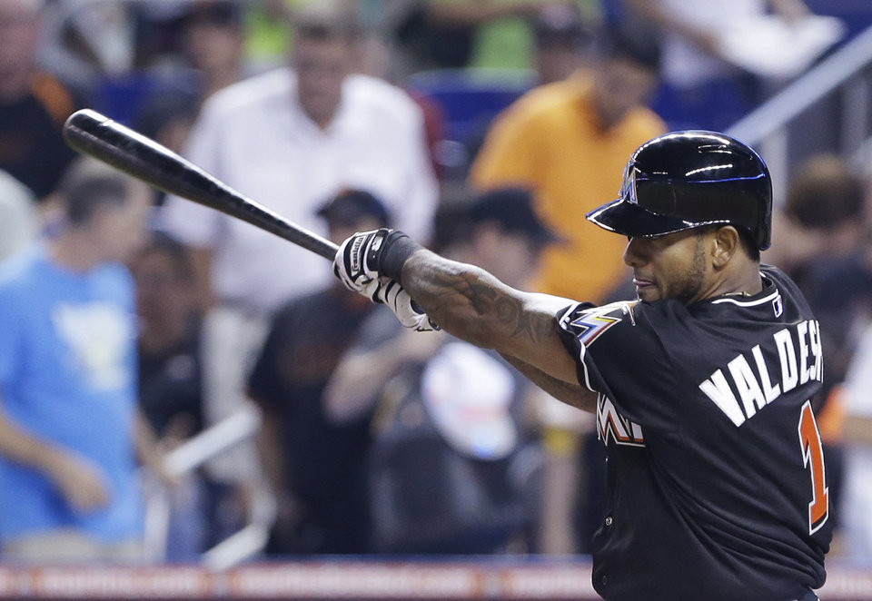 Photo - Miami Marlins' Jordany Valdespin singles during the first inning of a baseball game against the San Francisco Giants, Saturday, July 19, 2014, in Miami. (AP Photo/Wilfredo Lee)