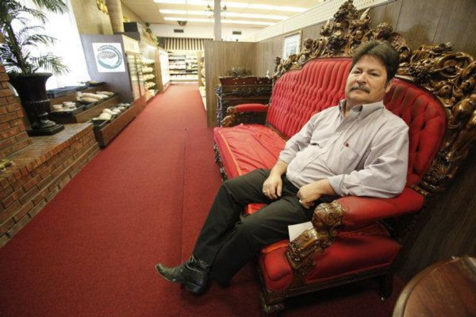 Robert Pemberton, owner of Crescent Market, rests in a lounging area used by elderly customers. <strong>Steve Gooch</strong>