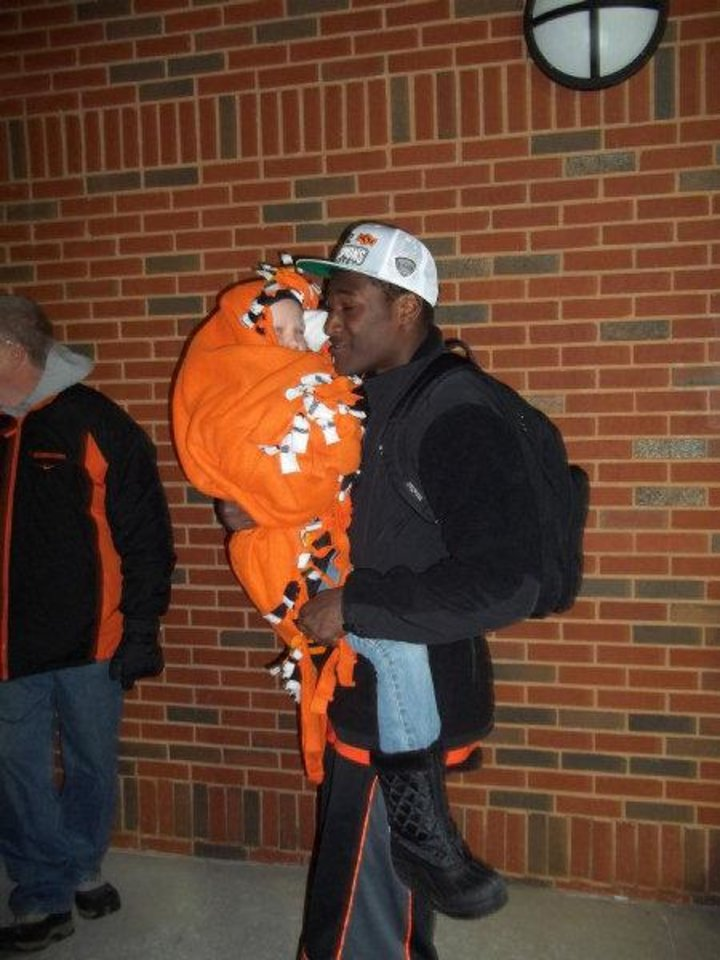 Photo - Justin Blackmon carries Olivia Hamilton after the Dec. 3 Bedlam game. PHOTO PROVIDED